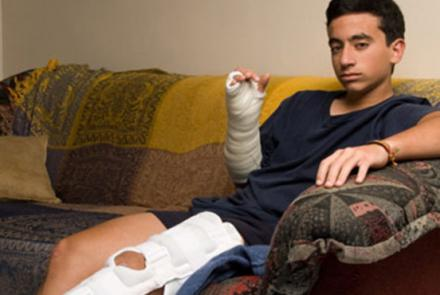 boy on couch with broken leg